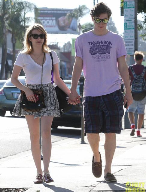 emma-roberts-evan-peters-holding-hands-o