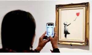 Bức tranh 1,4 triệu USD tự hủy đã được mua và đổi tên mới