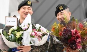Tae Yang và Dae Sung xuất ngũ trong sự chào đón của fan