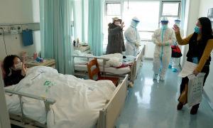 Bệnh nhân khỏi bệnh ở Vũ Hán bị cách ly bắt buộc 14 ngày