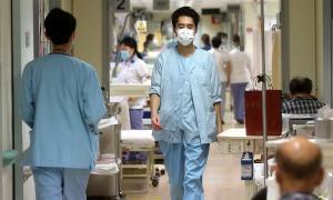 Trung Quốc 27/2: Số ca tử mới thấp nhất một tháng qua
