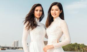Hoa hậu Siêu quốc gia mặc áo dài tạo dáng trên du thuyền