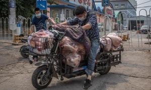 Covid-19 lại bùng phát ở chợ thực phẩm Trung Quốc