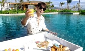 Tuấn Trần mặc đồ hiệu nghỉ dưỡng ở resort sang chảnh